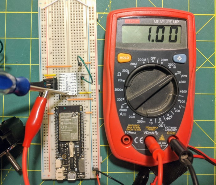 using a lead on the screwdriver turning the trimpot to sense voltage